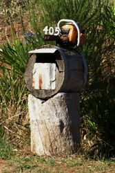 Cut through those bills with a chainsaw - log letterbox - Wilmot Tasmania