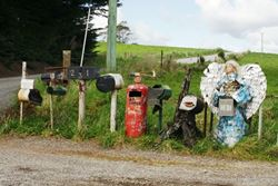 A variety of letterboxes here - a lizard climbing one, an angel made out of aluminium cans, and a fire extinguisher - Tasmania