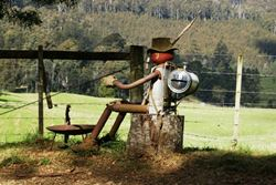 Old Swaggie kicking back by the campfire - this one is prepared for a cold night, he's even got a keg on his back! - Tasmania
