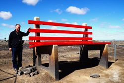 The Big Bench seat is 2.5 times higher than a normal bench seat and rests at the Lode Lookout giving panoramic views of Broken Hill in NSW.