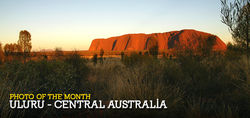 The soft morning sun softly touches the heart of Australia - Uluru