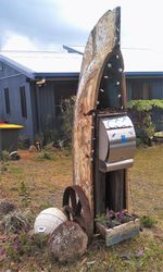 A great use for an old boat that no longer floats - retired to a life of a letterbox - photo by Vivienne Tracy