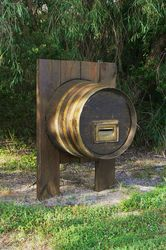 Reusing an preloved wine barrel for a letterbox - makes you want to whet your whistle - photo by Vivienne Tracy