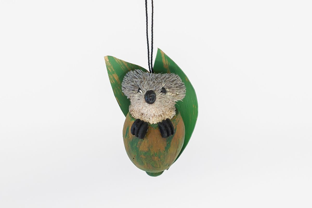 This very cute koala joey is tucked up inside a gumnut - a great tag idea for gifts. Avail